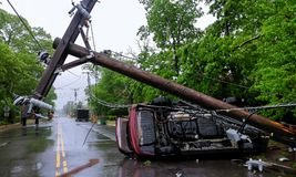 Car accident after a severe storm with crash electric pole. Car turned over after accident with crash electric pole after a severe storm Royalty Free Stock Photography