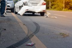 Car accident. A car accident. Traces of braking tires on the road surface. Warm light Stock Photos