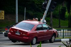 Car accident on traffic light at road intersection Royalty Free Stock Image