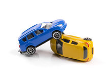 Car accident. Two toy cars isolated on white royalty free stock photos