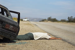 Car Accident Victim. Victim of car accident lying on roadside Stock Photo
