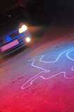 Car accident victim. A car accident scene with a dead body silhouette laying on the ground after he has been hit. Red and blue police lights combined with the stock images