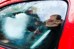 Car accident - Victim in a crashed vehicle Stock Image
