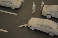 Car accident woman gets hit by a car at a parking lot. Road Safety. Symbol picture stock images