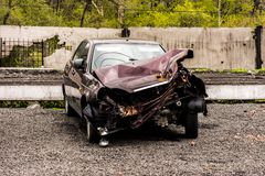 Car accident. A car in a car wreckers yard after a recent crash royalty free stock photography