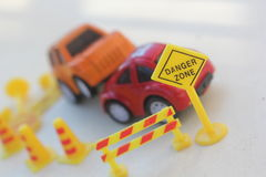 Car Accident zone cordoned off with a yellow stop sign post Stock Image