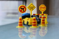 Car Accident zone cordoned off with a yellow stop sign post Royalty Free Stock Images
