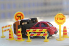 Car Accident zone cordoned off with a yellow stop sign post Stock Photos