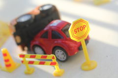 Car Accident zone cordoned off with a yellow stop sign post Royalty Free Stock Photo