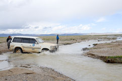 Car across the river in Tibet Royalty Free Stock Photo