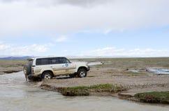 Car across the river in Tibet Stock Photo
