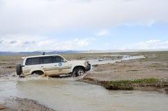 Car across the river in Tibet Stock Photos