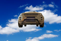 Car against a backdrop of blue skies among the clo Stock Photo