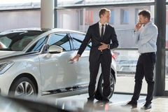 Car agent and customer stock photo