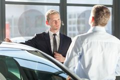 Car agent talking with customer Stock Images
