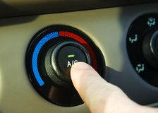 Car Air Conditioner. Turning on the AC in a hot car Stock Images