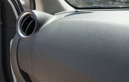car air conditioner grid panel on console Stock Image
