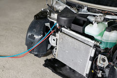 Car air conditioner repair. And filling with refrigerant Stock Images