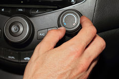 Car air conditioner service. Vehicle interior with visible climate controls, fragment of instrument panel Stock Image