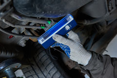 Car air-conditioner servicing. detection freon leak with ultraviolet lamp Royalty Free Stock Image