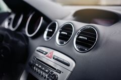 Car air conditioning. The air flow inside the car. Detail audio system buttons in car. Interior of luxurious sport car. modern car interior. air condition in Royalty Free Stock Photo