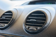 Car air conditioning system grid panel on console Stock Image