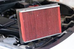 Car air filter change of new. In the engine Stock Photography