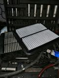 Car air filter while on the table, against the background of the tool stock photo