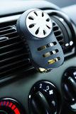 Car Air Freshener. A modern car's ventilation system with an air freshener on it. Shallow DOF, focus on the tip of the freshener royalty free stock images