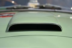 Car air intake. Of an old car with border chrome royalty free stock photo