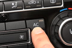 Car airconditioning. Finger pushing air conditioning button in car Royalty Free Stock Photos