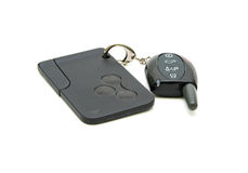 Car alarm key fob and a chip-card. Royalty Free Stock Photo