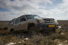 Car all terrain. Road vehicle work in the steppe Betpakdala, where there are no roads Royalty Free Stock Photography