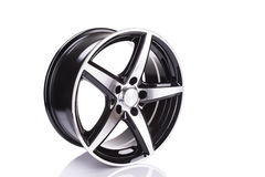 car alloy wheel, isolated over white background Royalty Free Stock Photography