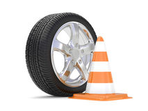 Car alloy wheel with road cone Stock Photo