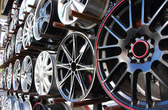 Car alloy wheel in store. Closeup Useful as background for design-works Stock Photography
