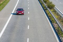 Car alone on a freeway stock images