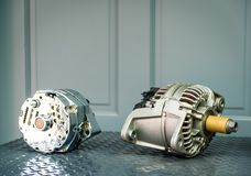 Car alternator on display on metal shelf/auto parts. Auto parts shop royalty free stock photography