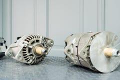 Car alternators on display on metal shelf/auto parts. Auto parts shop royalty free stock images