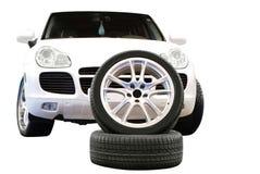 Car aluminum wheel and 4x4 suv isolated Stock Photo