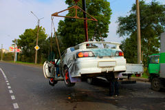 Car ambulance. Car removed from the place of the accident with a conventional tow truck Stock Photos