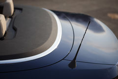 Car antenna. Color picture of a small antenna on the back of a car stock photos