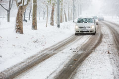 Car approaching on the street during heavy snowstorm Stock Photography