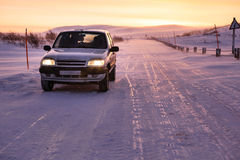 Car on the arctic road in day time. Murmansk Region, Russia Stock Images