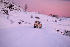 Car on the arctic road in day time. Teriberka, Murmansk Region, Russia Stock Photo