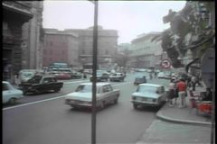 Car arriving at building entrance in Rome stock footage