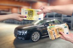 Car as background for female hands with euro banknotes stock photos