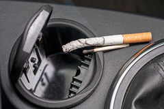 Car ashtray and  cigarette Stock Photography