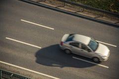 Car on an Asphalt Highway Road Stock Image
