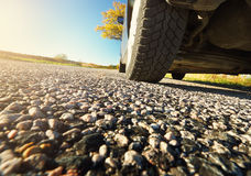 Car on asphalt road in autumnal evening Royalty Free Stock Photo